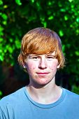 stock photo of puberty  - portrait of cute boy in puberty with red hair - JPG