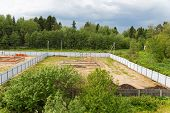 stock photo of foundation  - Building the foundation of houses in the summer - JPG