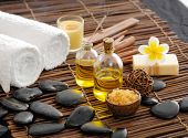 picture of frangipani  - wooden bowl in salt with frangipani with spa set on mat - JPG