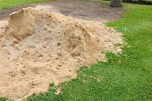 foto of sand gravel  - Pile of sand in public outdoor park - JPG