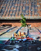image of spray can  - Used graffiti spray cans laying around at roof of abandoned warehouse - JPG