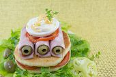 stock photo of tomato sandwich  - Homemade ham sandwich with olives tomato and cooked eggs - JPG