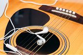 picture of risque  - Close up earphone on guitar  - JPG