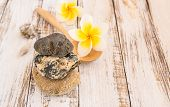 foto of stone-therapy  - Stone therapy and tropical Plumeria on wooden table for spa and wellness concept - JPG