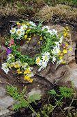 image of wildflower  - Wildflower wreath on dark brown wooden background - JPG