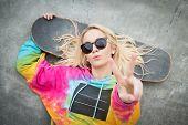 image of nose ring  - Pretty blond skater girl giving peace sign - JPG