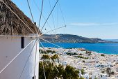 image of greek-island  - White greek windmill overlooking traditional village on Mykonos Island - JPG