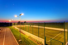 foto of football pitch  - Small football pitch in sports center at night - JPG