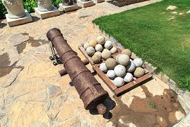 picture of cannon-ball  - Many of historical old cannon balls heap of stone balls - JPG