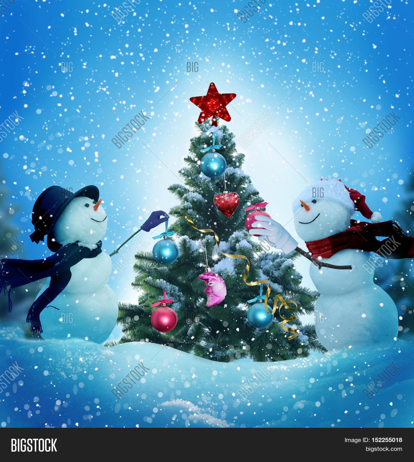 Christmas Tree Merry Christmas: Snowmen Decorating Christmas Tree. Image & Photo