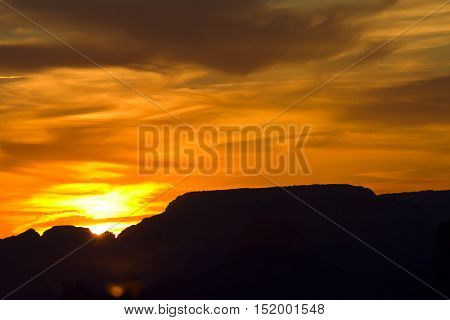 View of swirling sunset sky of light shadow and clouds from Navajo Point in Grand Canyon National Park in Arizona USA. Horizontal landscape with copy space.