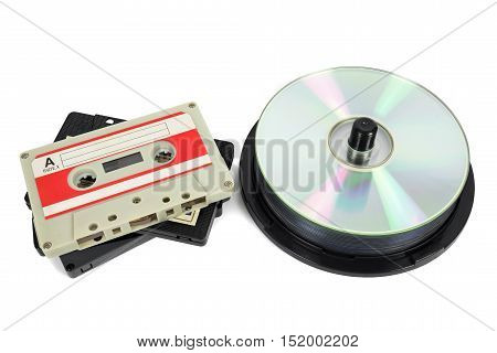 Audio cassettes and CDs isolated on white background with clipping path