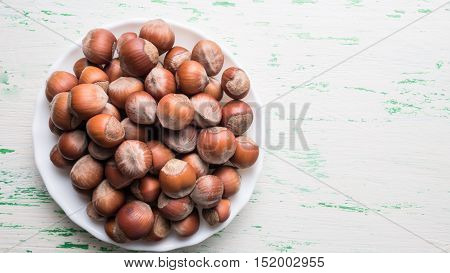 Nuts in the shell on a wooden Board closeup