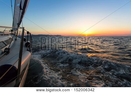 Sailing yacht in the Aegean sea during twilight.