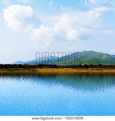 Seaview with beautiful white clouds and mountains.