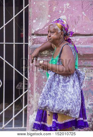 HAVANA CUBA - JULY 18 : A portrait of a Cuban woman in old Havana street on July 18 2016. The historic center of Havana is UNESCO World Heritage Site since 1982.
