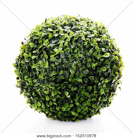 Sphere from green artificial grass isolated on white background.