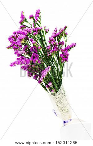 Bouquet from purple statice flowers arrangement centerpiece in vase isolated on white background.