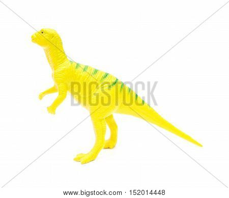 side view yellow plastic dinosaur toy on a white background