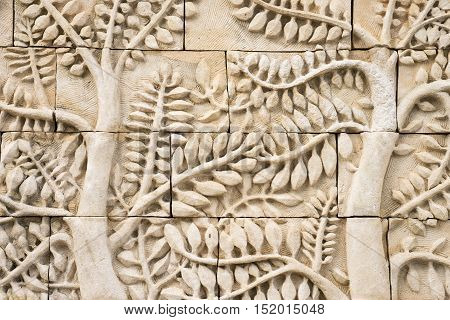 Low relief cement Thai style handcraft of tree