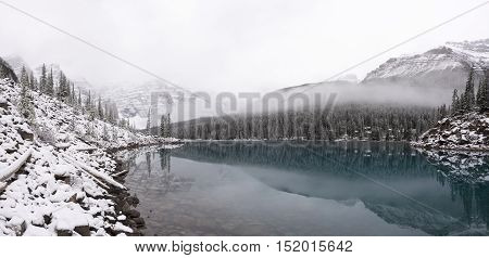 Moraine lake after a dusting of fresh snow in the fall