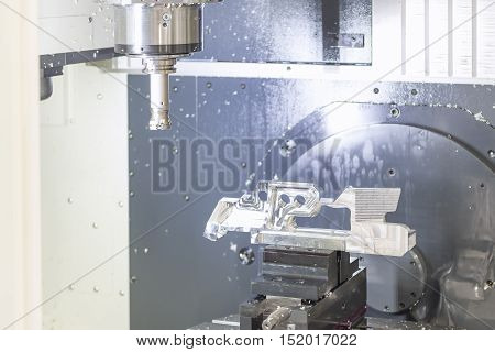 The CNC machine while prepare cutting sample work piece.The Vertiacal Milling CNC machine with indexable cutting tool and sample work piece.
