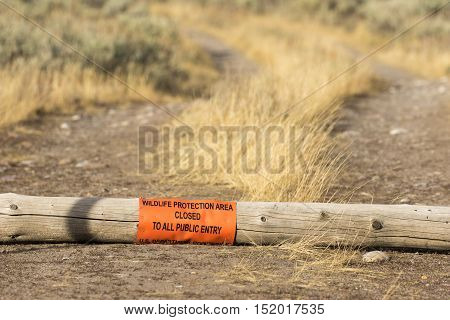 Protected area with wildlife protection sign near road