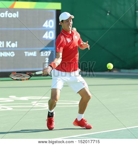RIO DE JANEIRO, BRAZIL - AUGUST 14, 2016: Olympic bronze medalist Kei Nishikori of Japan in action during men's singles bronze medal match of the Rio 2016 Olympic Games at the Olympic Tennis Centre
