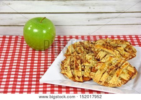 apple pie cookies with granny smith apple on checkered tablecloth