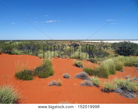 View of the Outback, Northern Territory, Australia, with a dried salt lake (right on the horizon line).