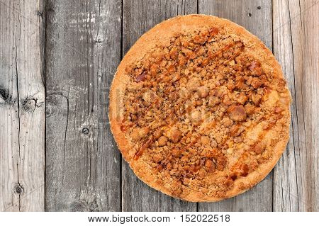 Apple, Caramel Crumb Pie, Above View Against A Rustic Wood Background