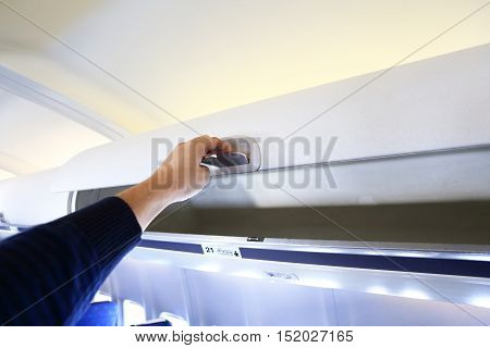 Hand Opening White Panel For Luggage.in Airplane