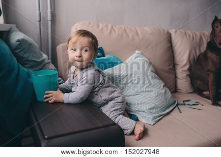 cute happy 11 month baby boy playing at home lifestyle capture in cozy modern interior