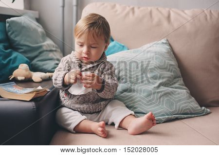 cute happy baby boy playing at home. Lifestyle indoor capture