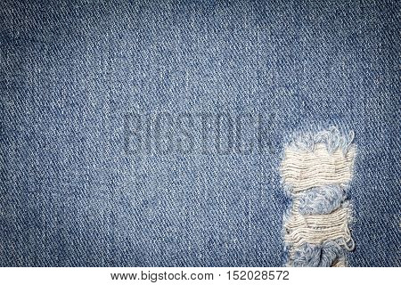Denim jeans texture or denim jeans background with old torn of fashion jeans design with copy space for text or image. Dark edged.