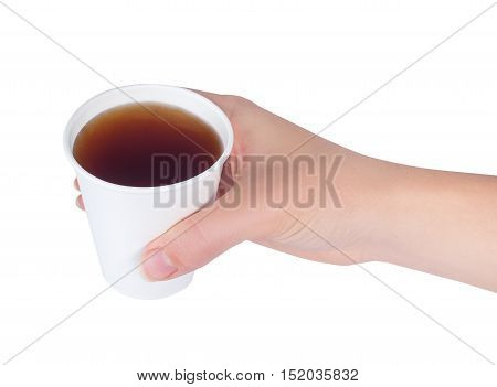 hand holding white paper cup of tea isolated on white background. Woman holds a disposable cup over white background. Female's hand with paper cup
