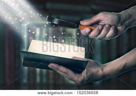 Opened Magic Book With Loupe Magic Light