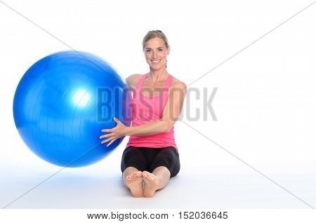 Smiling Healthy Woman Holding A Pilates Ball