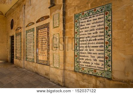 JERUSALEM ISRAEL - APRIL 29 2015: Text of the Pater Noster prayer different languageson in the Church of the Pater Noster on Mount of Olives. Israel