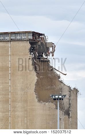 detail of demolition of silos in italy