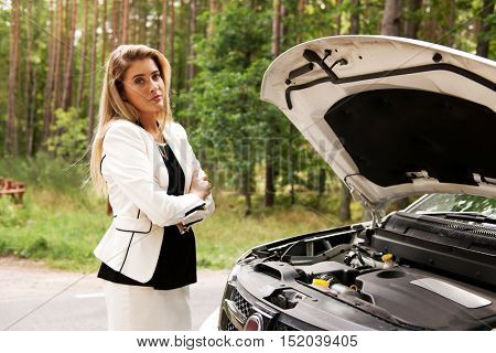 Woman opened the hood broken car