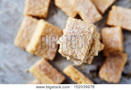 Delicious homemade sugar cookies made from semolina, butter, flour and sugar. Crumbly, delicate texture, the sugar crust on top. A little sweetness to the tea on gray background. Selective focus