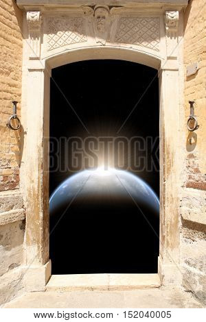 Frame with ancient door and space scene with planet, stars and sun. Elements of this image furnished by NASA. 3d render