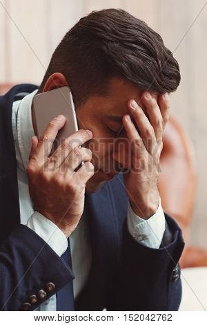 Man receiving bad news on the phone. Family problems, relationship concept.