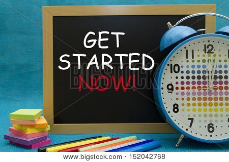 GET STARTED NOW message written on a small blackboard.