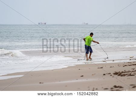 Young Fisherman On The Beach