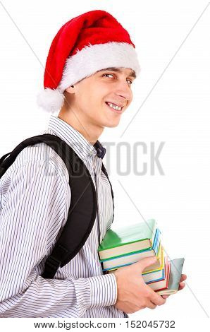 Student in Santa Hat with a Books on the White Background