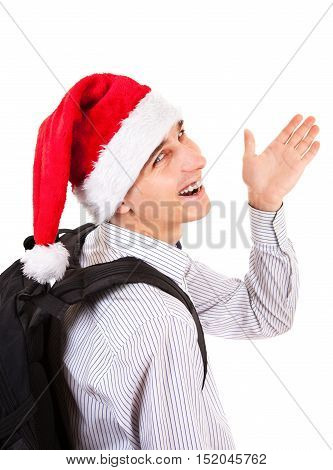 Happy Teenager in Santa Hat wave Goodbye on the White Background