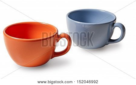 two cups, orange and blue, on white background