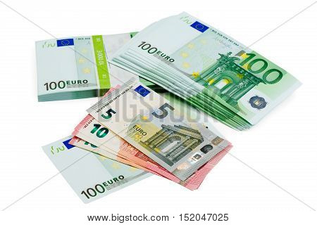 Euro banknotes of different denomination closeup isolate on white